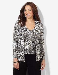 Layered-look top mixes animal prints with subtle metallic glitter for exotic shine. A silky, lightweight jacket drapes gracefully over an attached scoopneck tank below. Long sleeves. Asymmetrical hem. Catherines tops are designed for the plus size woman to guarantee a flattering fit. catherines.com