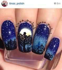 Girl in a tree at night nails