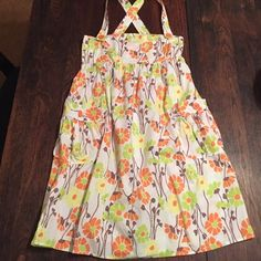 Urban Outfitters floral sun dress Urban Outfitters, specifically brand Lux, yellow/orange/green flowered sun dress, pockets on either side, button closure on left, cross back straps Urban Outfitters Dresses