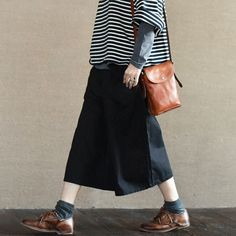 """Black Culottes Wide-legged Pants Causel Women ClothesClothes will not shrink,loose Cotton fabric, soft to the touch.*Care: hand wash or machine wash gentle, best to lay flat to dry.*Material: Cotton 100% Weight:470g*Colour:Photo colour*Model size: Height/Weight: 168cm/49kg B/W/H(cm):84/68/90*Measurement(It can fit size M,L well.)Length: 77cm / 30""""Waist: 66-100cm / 26""""- 39.4""""Front Rise: 38cm / 15""""After the fork: 45cm / 17.7""""Hip: 136cm / 53.5""""Thigh : 76cm…"""