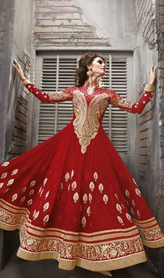 This shade of vermillion color when used right can literally cause magic and that is what this red faux georgette semi stitched abaya style kameez heavily embellished with contrasting resham, zari, stone, applique, gota. Trajes Anarkali, Anarkali Dress, Kebaya Dress, Indian Anarkali, Red Lehenga, Anarkali Suits, Lehenga Choli, Abaya Style, Pakistani Outfits