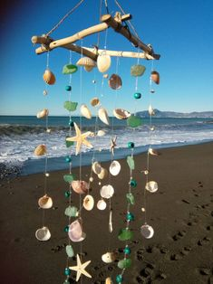 26 Fresh Spring Porch Signs to Welcome the New Season with Style - The Trending House Seashell Wind Chimes, Diy Wind Chimes, Seashell Art, Seashell Crafts, Beach Crafts, Seashell Mobile, Diy Crafts Hacks, Diy And Crafts, Shell Decorations