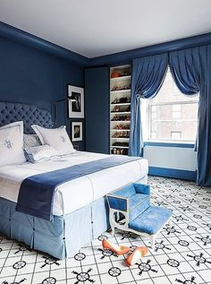"""Farrow & Ball's Pitch Blue informed the design of the master bedroom. """"Once we decided on the blue for the walls—a color I feel is so French—I thought, Let's be super French about it,"""" says Kate. """"SoI put in the Madeleine Castaing carpet and went with a really deep French-style tufting on the headboard."""""""