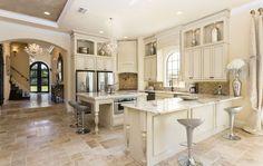 Reunion Resort 6000's open plan kitchen makes entertaining luxurious and entertaining.  #contemporary #design