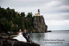 Bride & groom with the famous Split Rock Lighthouse in the background. Wedding photo taken with the Tamron SP 150-600MM F/5-6.3 Di VC USD lens and Canon 5D Mark III camera at 180mm.