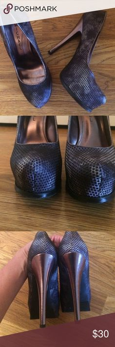 "Michael heels Gorgeous 🎉❤️5.5"" heel in excellent condition. Nice snake skin look with bronze colored heel. Hardly worn Shoes Heels"