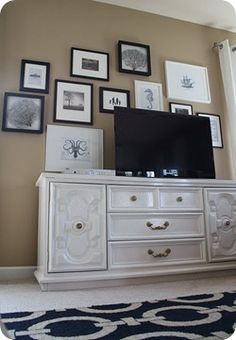 Wall art above TV , possible black and white family pictures