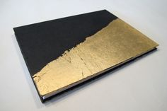 Large Gold Metal Leaf Wedding Guest Book: Black and Gold Journal Notebook Coptic Book by PaperJayneDebbie on Etsy https://www.etsy.com/listing/159711104/large-gold-metal-leaf-wedding-guest-book