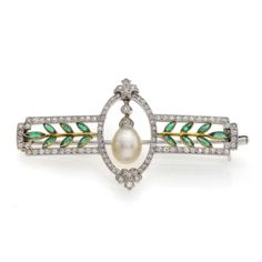 An Edwardian diamond, natural pearl and emerald brooch, finely set in platinum and gold, length 5 cm. C.1910.