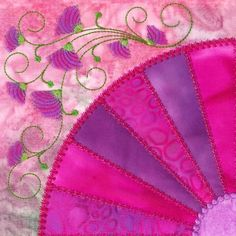 Fan quilt with embroidery. I love this design!