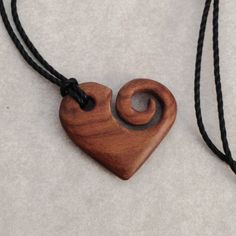 #heart #koru #necklace I carved from rosewood