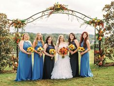 Stunning light blue and navy bridesmaid dresses and fall bouquets...love it! See more from this outdoor fall wedding in Knoxville at @reserveatbbh! Flowers by @samuelfranklins, bridal attire @alfredangelo, and pics by @jophotos. | The Pink Bride® www.thepinkbride.com