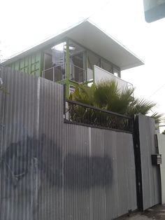 Look at this container house spiral staircase. Too be fair, it is comprised of 3 separate units: store front 1st floor; 2 bed/bath 2nd floor; 1 bed room 1 1/2 bath 3rd. Oh! roof deck! Yes, please!