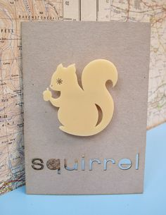 Laser cut retro squirrel brooch. £9.00, via Etsy.