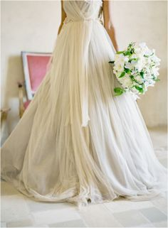 I love this off-white wedding dress and the white and green bouquet. I love how romantic and flowy the material is. #romanticweddingdress #whitegreenbouquet