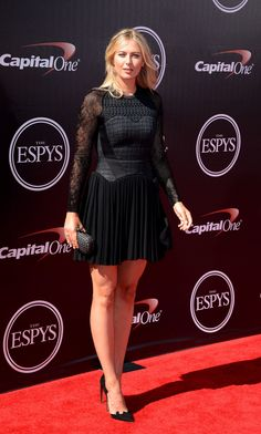 Tennis pro Maria Sharapova attendsthe 2014 ESPYS at Nokia Theatre L.A. Live in LA showing off her amazing figure in this structured black dress. via StyleList   http://aol.it/1zMyLuI