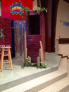 Completed spot for Flame and puppeteer. Use one large box or two small ones and tape them together. Add greenery. Cut and cover pool noodles to complete the set. cokesburyvbs.com