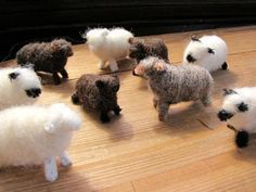 These little lambs are made of black pipe cleaners, and wound around with white wool roving then gently needle felted. We made dozens of these for Christmas one year and tied homespun scarves, twine and a bell around the neck. Cute in a manger scene.