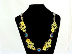 Peacock necklace with brillant one of a kind art crystals. #fashion #art #jewelry #vintage #vestigejewelry