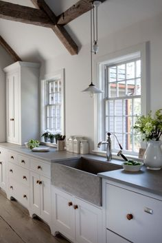 rustic kitchen with stainless steel farmhouse sink | Connecticut Cottages & Gardens