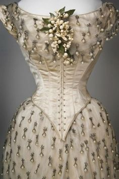 orange blossom corsage and pearl drops on wedding gown, likely 19th century.