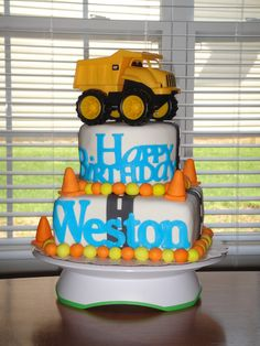 """Dump truck cake made using all MMF. The bottom tier is 8"""" square and the top is 6"""" round. The phrase """"Happy Birthday"""" and name """"Weston"""" were cut out using my new Cricut Cake machine."""