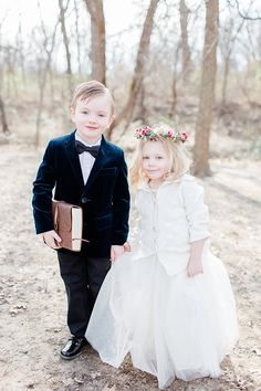 darling ring bearer and flower girl with a puffy dress and flower crown