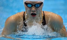 China's Ye Shiwen competes in the women's 200m individual medley final during the swimming event at the London 2012 Olympic Games on July 31, 2012 in London. She won gold