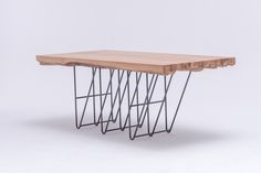 Masiv OAK is a unique piece of art. A statement table. A sculpture table. A dream table. It attracts attention from all angles. MASIV is built on a very strong contrast between the natural wooden top and delicate graphic-like steel construction. You can never have two identical MASIVES, every product is original. To bring it to life an unrepeatable composition of raw oak boards is designed every single time, to maintain  the natural beauty of the wood. www.stfurniture.com