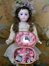 """a antique small sewing box filled with many little thinks. A hand woven straw basket with lid....covered with pretty pink padded silk and filled inside with lovely sewing items and you can see a small mirror in the middle of lid... It is from France around 1900th. century. 6,5"""" x 4,5"""" x 3"""""""