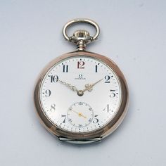 Omega pocket watch with red twelve, from 1916 via MarCels. Click on the image to see more!