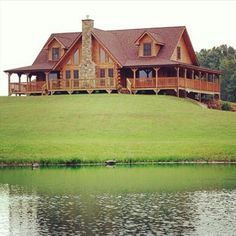Beautiful log home! Perfect front yard too. Can watch the kids fish!!!