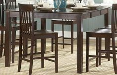 Homelegance 5365-36 Tully Counter Height Kitchen Table, by Homelegance. $409.43. Solid wood table top. Extension Leaf Counter Height Table. Belongs to Tully Collection. Square Table Top Shape. Transitional Style. What is included:Counter Height Table (1) The casual design of the Tully Collection allows seating for up to eight. Solid wood table top in warm cherry finish and its transitional styling make this counter height set a welcoming addition to your home.