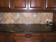 Small Kitchen Design Using Black Granite Kitchen Counter Tops Including Diagonal Cream Stone Tile Kitchen Backsplash Dark Cabinet And Solid Cherry Wood