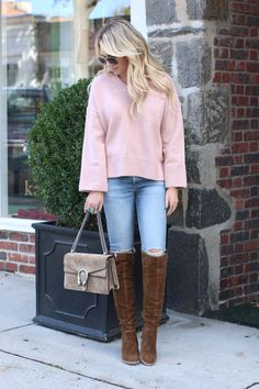 Fall fashion staples. Great list of must have boots including these brown suede Stuart Weitzmans. Love this oversized sweater and suede purse.