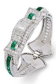 An Art Deco Emerald, Diamond and Platinum Bangle Bracelet, Oscar Heyman, circa…