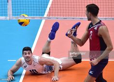 Filippo Lanza (L) of Italy reacts against Aaron Russell from the United States of America during the men's volleyball preliminary match at the 2016 Rio Olympic Games in Rio de Janeiro, Brazil, on Aug. 9, 2016. Italy won the match with 3:1./ CHINA OUT