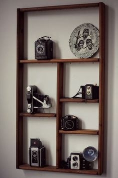 Shelf display with vintage cameras *Need something like this for mine!!