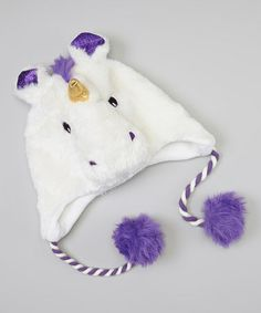Take a look at this White & Purple Unicorn Faux Fur Earflap Beanie by Aquarius on #zulily today!