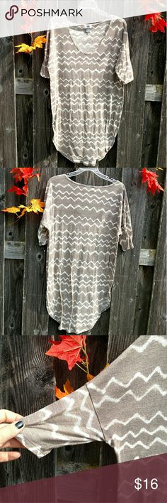 SOLD TO SISTER Light Brown and Cream Chevron Top ❤Made in Indonesia ❤Material tag is cut off so I'm not sure what it's made of ❤No trades ❤Reasonable offers always welcome ❤Cleaned and ironed   This top is very soft and is technically a tall size but I think it would be perfect for any sized person to wear with leggings and a cute cardigan.💖 Please comment if you have any questions 💖🌈🍂 Old Navy Tops