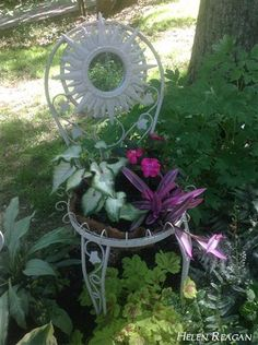 Found this cute chair at a yard sale. Took out the seat and back cushions. Replaced back with a sunburst mirror that I painted to match and the seat with a hanging wire planter. I had to plant it with shade plants because we have very little sun in our yard.