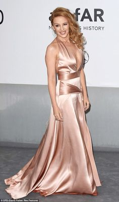 Sweeping glamour: Kylie's satin dress was a dream of satin fabric...