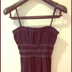 """NWOT Theory Denim Ruched Midi Dress Theory Dark Indigo denim dress. Adjustable straps. Ruched empire bust and midi length (hits me below calf and I am 5'6""""). Never been worn, NWOT. Size small but its big on me. I would say best for size 2-4 but even a small 6 since there's room due to the ruching Theory Dresses Midi"""