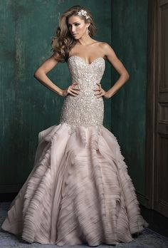 Allure Couture. Couture gown features columns of organza ruffles, offsetting a richly beaded bodice.