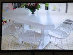 Vintage table done in high gloss white, paired with mid-Century chairs. Really appealing mix!