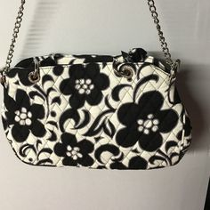 Vera Bradley purse NWOT. This stunning Vera Bradley purse in the Night & Day pattern features a zippered compartment with additional inside zippered compartment and chain accents. From a nonsmoking home. Vera Bradley Bags