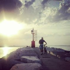 Laura Johnston - Sun setting at the harbour in Rimini. Where my girlfriend is from and where both our hearts are calm. Captured a moment where this local man was trying to get the last moment of summer sun