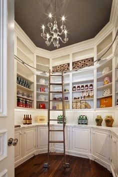 walk in pantry with painted gray ceiling, chandalier and library ladder  for the top shelves. awesome.