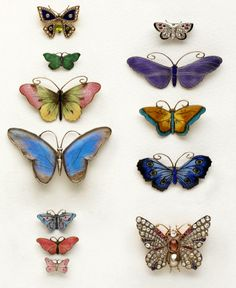 Vintage butterfly brooches via Homes & Antiques. I have one similar to the little pink one 2nd from bottom on the left!!