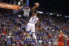 Kansas guard Kelly Oubre Jr. (12) delivers a dunk on a breakaway during the first half on Saturday, Jan.10, 2015 at Allen Fieldhouse.
